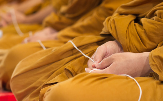 Thai bhuddhist monks are praying in a ceremony